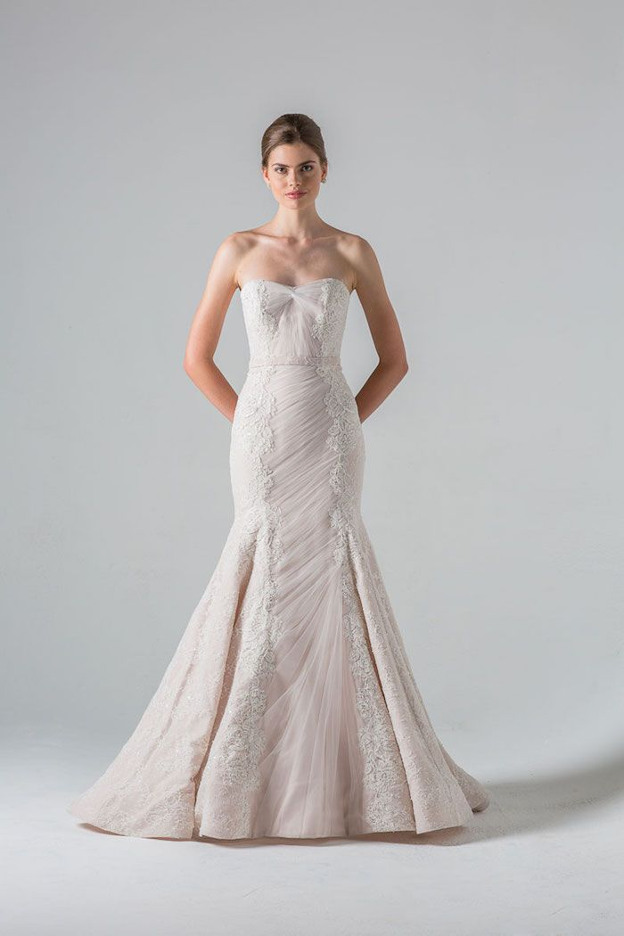 Anne Barge mastered this unique wedding dress complete with soft ruching and glorious lace panels. Dress: Anne Barge