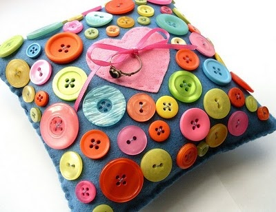 This blog suggests making this fun button pillow as a ring pillow. I don't know about using it for a wedding, but I really like the idea of this project! Cute :)