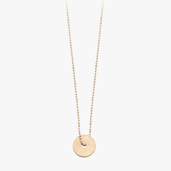 Ginette NY collier pendentif disque http://www.vogue.fr/joaillerie/shopping/diaporama/chaines-colliers-minimalistes-seconde-peau-or/19922/image/1041755#!ginette-ny-collier-pendentif-disque