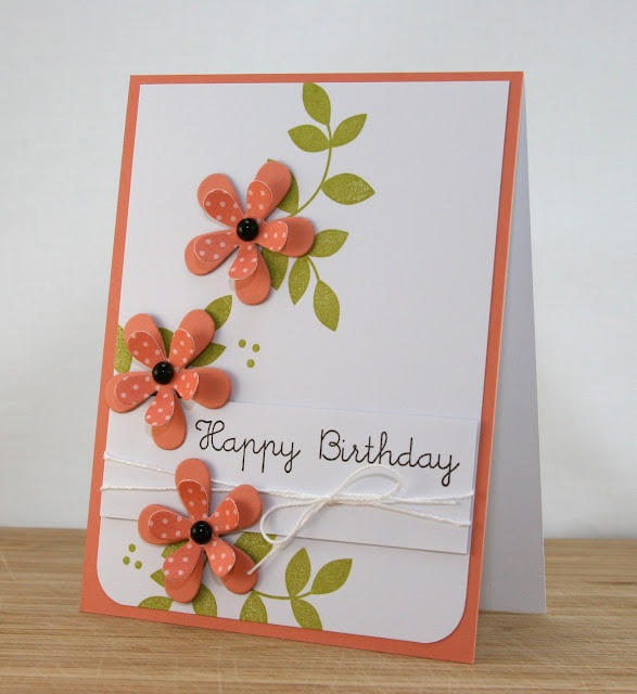 like these die cut flowers with polka dot paper for the top layer...