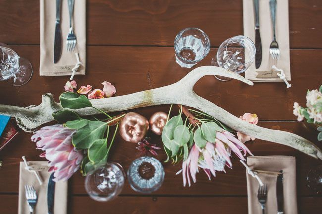 King Protea and gold apples make for a fun + unique centerpiece