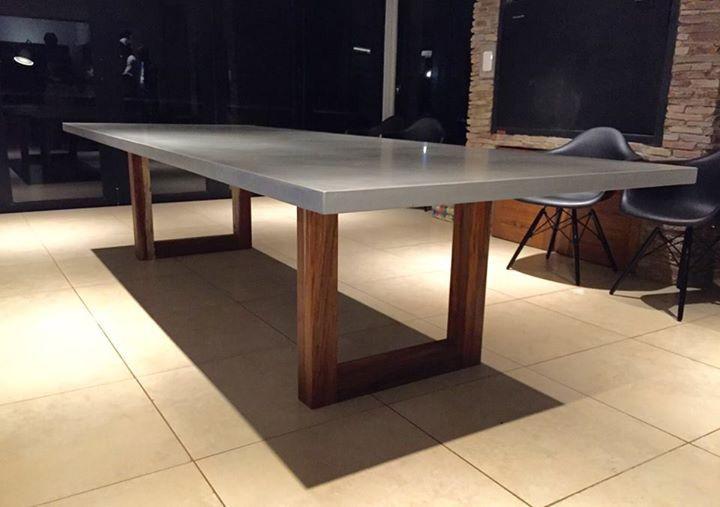 Polished concrete patio table with kiaat base. Projects@floatdesign.co.za