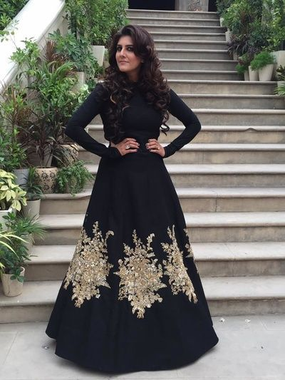 Black Sabyasachi gown with gold embellishments is perfect for a cocktail night | Curated by Witty Vows – Things No one tells brides |The ultimate guide for the Indian Bride to plan her dream Indian wedding. Real weddings, ideas, trends, recomendations and inspiration | ♥ ♥ ♥ | Photo credit - wedmegood.com | #groom #fashion #IndianGroom #IndianWedding #menswear | www.wittyvows.com