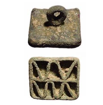 Bactrian Amlash bronze compartmented stamp seal with geometric, Afghanistan, 2000-1500 B.C. 4.4 cm long. Private collection