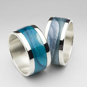 "Enamel rings by Rachel Emmerson ""Feathers"" hand engraved with different shades of blue."