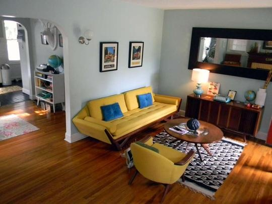Pale blue walls with mustard yellow furniture living for Mustard living room ideas