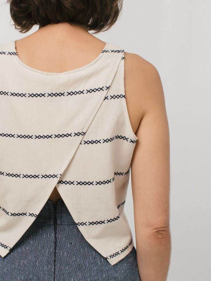 An open back sleeveless top with a cropped and boxy feel. Featured in our custom textile exclusively woven with intricate and geometric brocade detail, a lightweight and casual top in natural blue and nude shades. Available in size XS, S, M or L.100% cotton  Handmade in Guatemala  Machine wash cold on delicate cycle, lay flat to dry.Due to the handmade weaving nature of our clothing each piece varies slightly in texture and color. We love that one-of-a-kind feel.A collaboration with Casa…