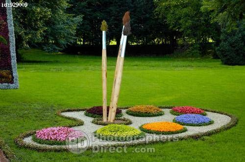 Conceptual Artistic Sculpture Made From Flowers Paint Brushes And Palette