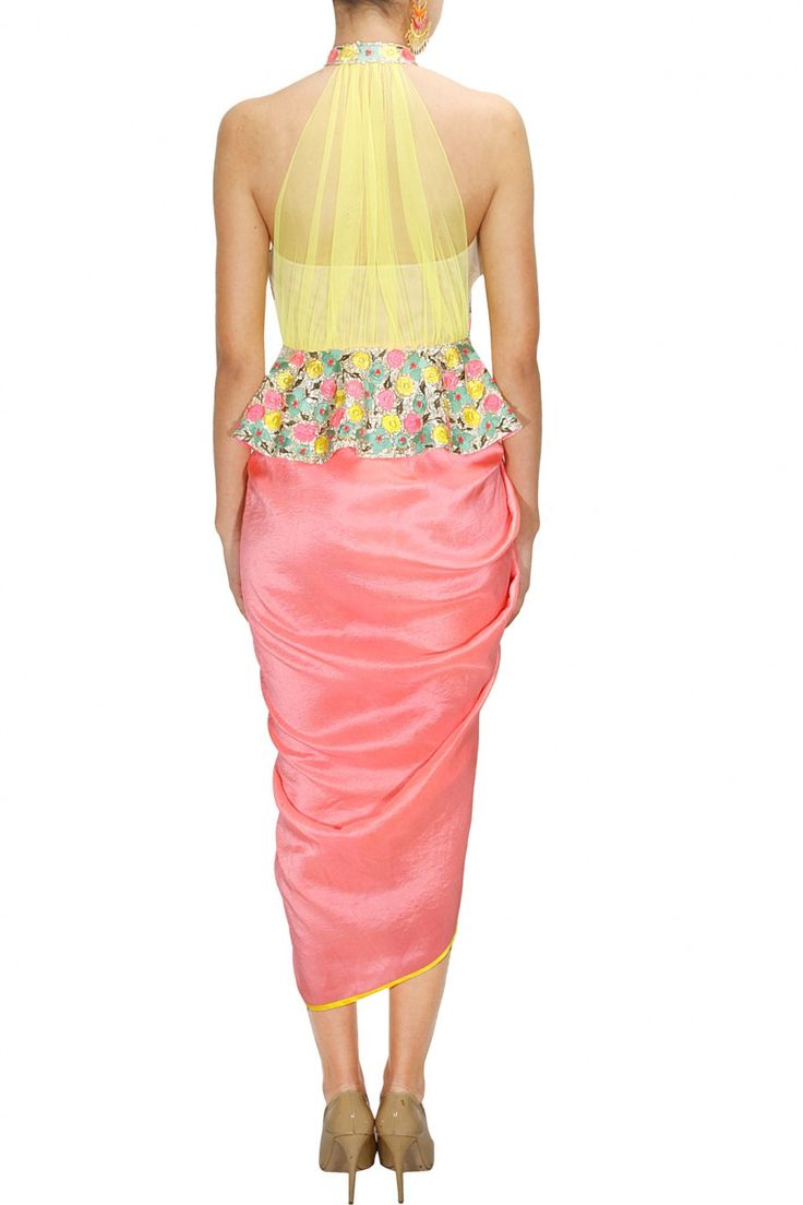Multicolour coin and thread work peplum jacket with salmon dhoti wrap skirt available only at Pernia's Pop-Up Shop.