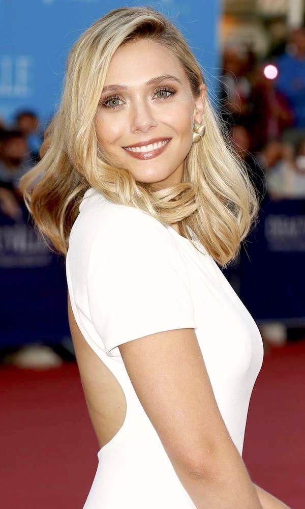 Elizabeth Olsen // side parted hair, statement earrings, bronzed beauty & open-back white dress #style #fashion #celebrity