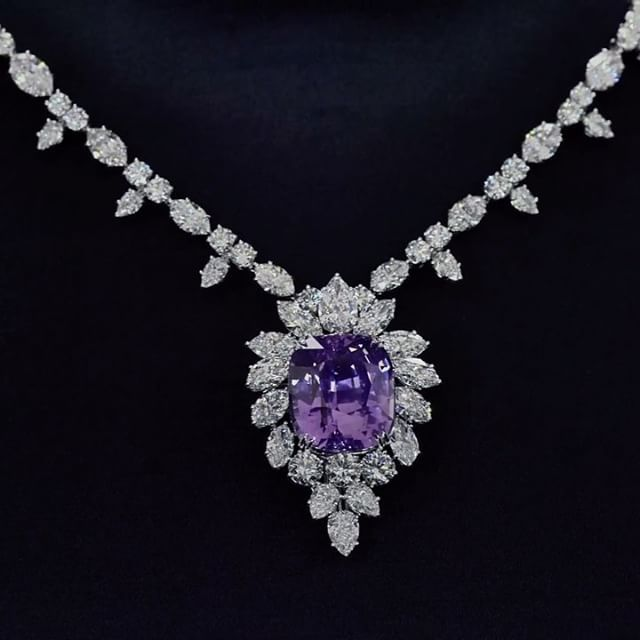 Harry Winston. With an ultra-rare 65.32-carat pink-purple sapphire and diamond necklace.