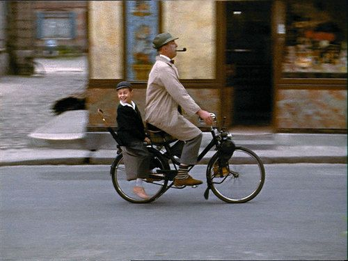 Jacques Tati and Alain Bécourt ride a bike.    Tags: 1959 Academy Award foreign language film Jacques Tati Mon Oncle Monsieur Hulot velo