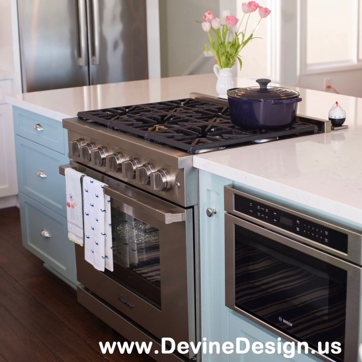 Custom kitchen island for a client who loves the casual elegant look of Pottery Barn. The island is in a contrasting color to the rest of the kitchen which has white kitchen cabinets