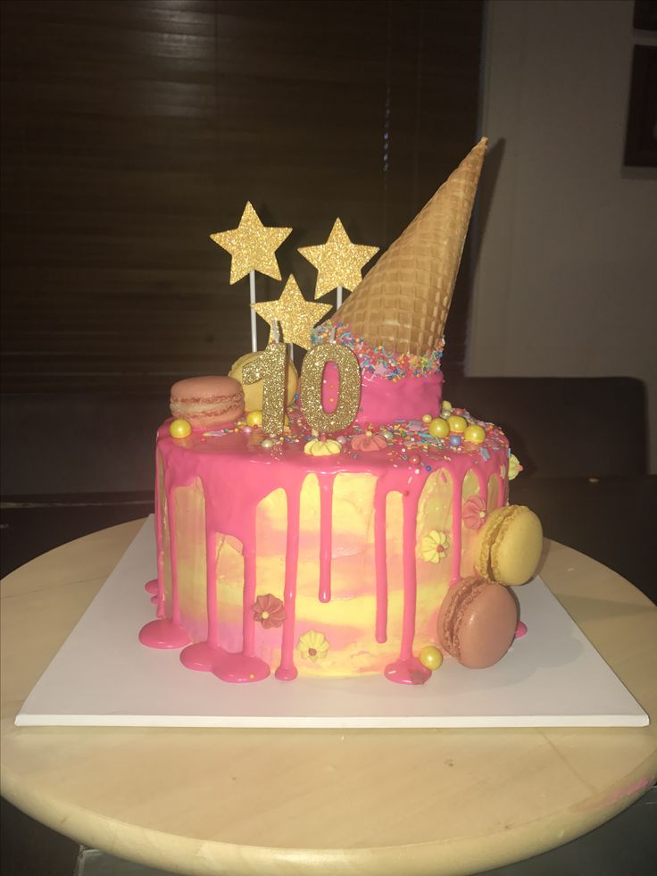 My daughter Janae's 10th birthday cake. Ice cream cone drip cake with watercolour buttercream and white chocolate mud cake.