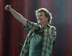Rick Allen Drummer for Def Leppard Lost his arm in a car accident and still play's with the band ..