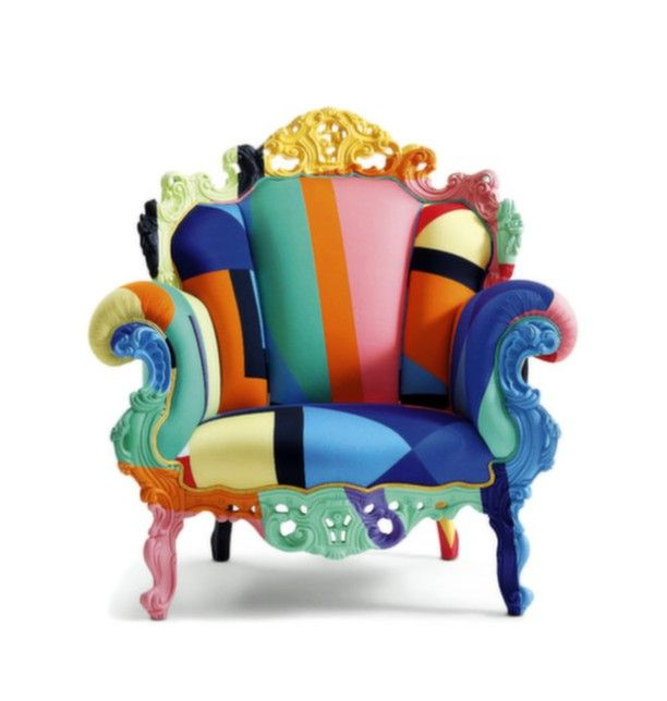 Multi-Coloured Armchair By Cappellini. The Proust Geometrica armchair with wooden frame designed by Alessandro Mendini is upholstered and hand-finished. The multi-coloured fabric breathes new life into the traditional design in the quest for aesthetic perfection.