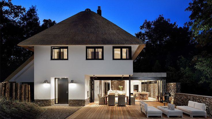 Modern house with thatched roof, Zeeland, the Netherlands. Design by BNLA architecten. Photography by Studio de Nooyer.