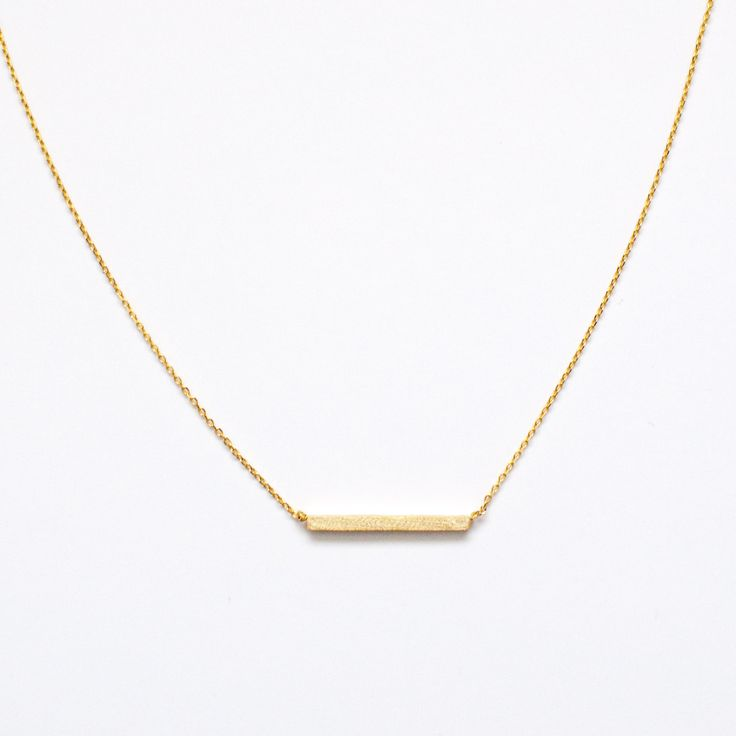 "dainty gold bar necklace - perfect for the minimalist and simple accessorizing. 16"" chain length gold plated"