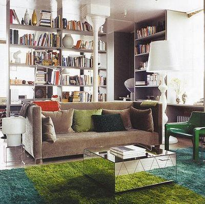 living // gray couch, mirrored chevron table, books
