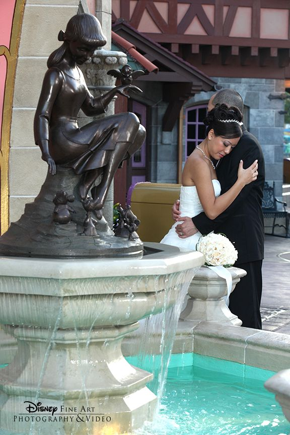 . A sweet moment by Cinderella's Fountain at Walt Disney World's Magic Kingdom