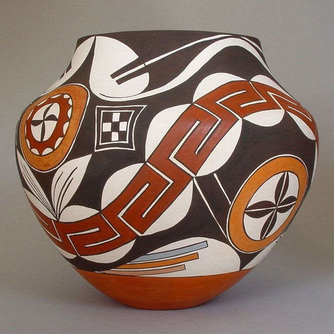 This is an unusually striking polychrome olla (water-carrying vessel) by veteran Acoma potter Marie Juanico.