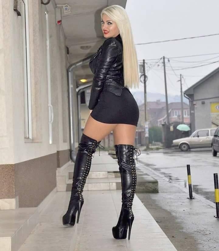 Blonde Leggy In Short Black Leather Jacket Mini Skirt
