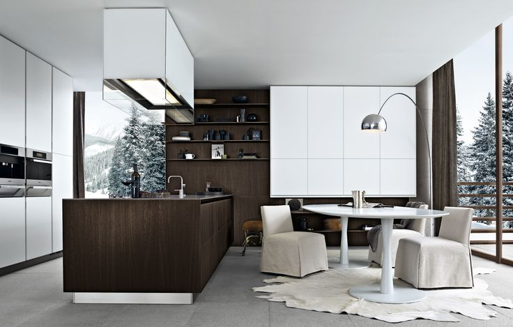 Kitchen Twelve in spessart oak, worktop thickness 12 mm in polished quartzite raven sand, tall units and wall units bianco embossed lacquered. Island-hood Glass.