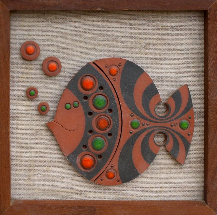I have some cool ceramic plaques -- it would be cute to set them off on a burlap or raw silk background in a frame ala this.