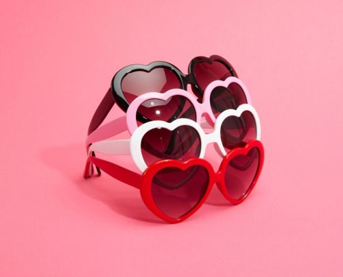 black, red, white, and pink heart sunglasses with black shades. Too cute!