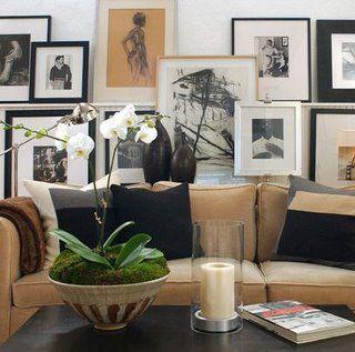 Layered art wall, camel sofa | David Jimenez