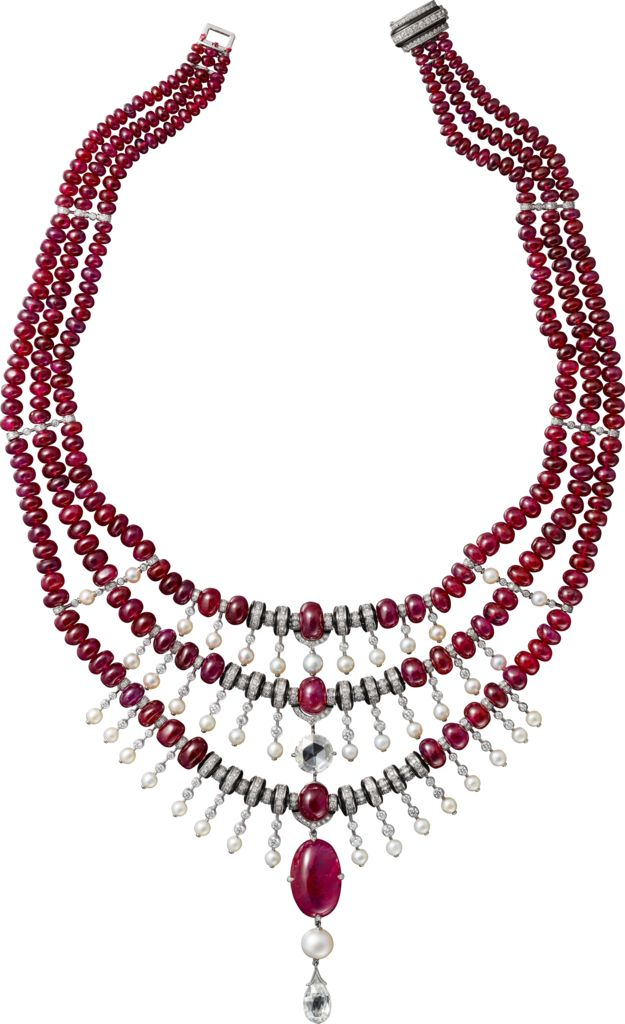 CARTIER. Necklace - platinum, one 17.45-carat ruby from Tadjikistan, one 3.17-carat F VS2 briolette-cut diamond, one 2.01-carat H VVS1 rose-cut diamond, one 12.04-grain natural pearl, fourty-one natural saltwater pearls totaling 64.72 grains, ruby beads, calibrated rubies, onyx, brilliant-cut diamonds.
