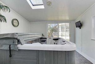 Transitional Hot Tub with Fence, Skylight, exterior stone floors