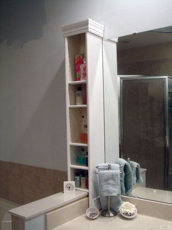 Repurpose DVD Stand as Bathroom Storage — add crown molding and paint!