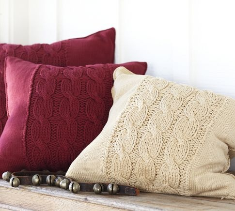 Cable knit pillow in cream from Pottery Barn.