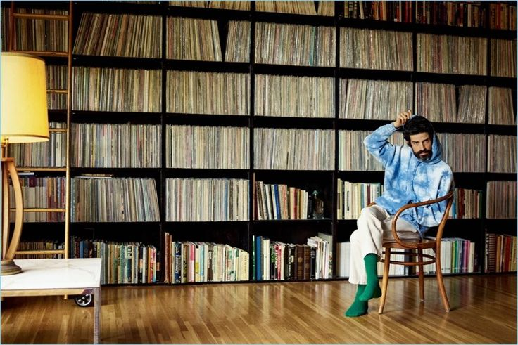 Appearing in a Mr Porter photo shoot, Devendra Banhart rocks a Beams tie-dye hoodie, By Walid trousers, and The Workers Club socks.