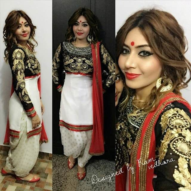 Black and white suit wtih red dupatta