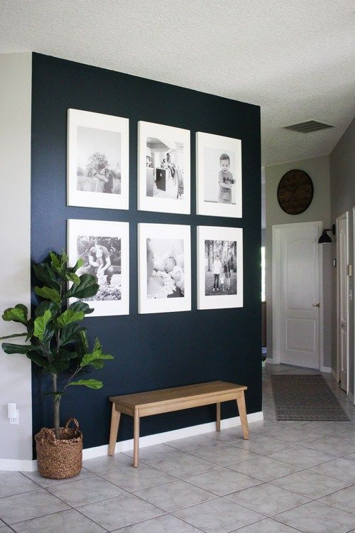 Dark Blue Wall With White Frames