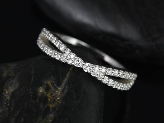 This gorgeous design is a spin off of infinity rings. This is designed so that it will sit fairly close to the straight engagement ring bands. With