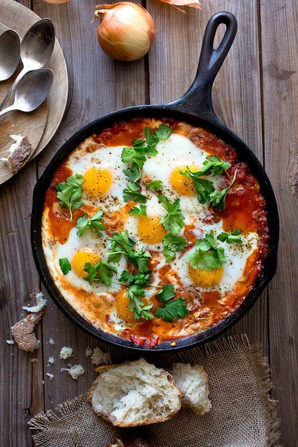 Shakshuka may be at the apex of eggs-for-dinner recipes, though in Israel it is breakfast food, a bright, spicy start to the day with a pile of pita or challah served on the side. (It also makes excellent brunch or lunch food.) It's a one-skillet recipe of eggs baked in a tomato-red pepper sauce spiced with cumin, paprika and cayenne. (Photo: Andrew Scrivani for The New York Times)