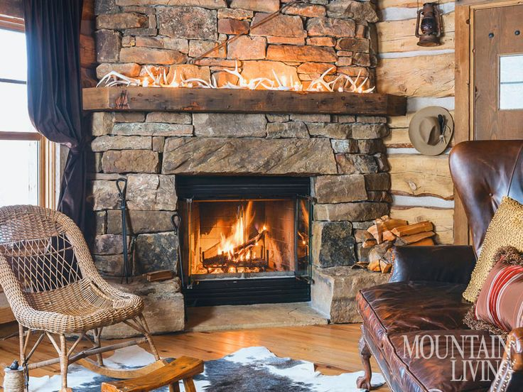 Fireplace stone fireplaces mantels wood beams for Cabin fireplace pictures