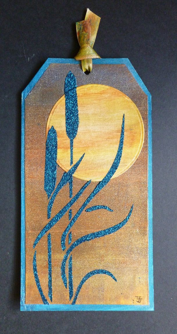 'Evening Sunset' Tag. - Imagination Craft's - Magi-bond glue.  Small brayer.  Hibiscus, Blue, Canary yellow & Orange Oxidized Starlight paints.  Teal Sparkle Medium.  Metal spatula.  Bulrushes panel stencil.  April 2017.   Designed by Jennifer Johnston.
