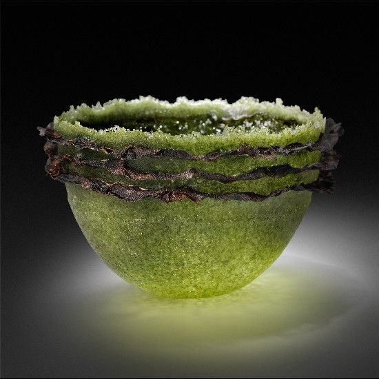 Patty Roberts | Patty Roberts works with the glass kiln casting technique of Pate de verre. It was a style created by early French glass artists and means paste of glass. The process begins by creating the original art in clay, making a mold, lining it with several layers of the glass paste and firing it in a kiln.