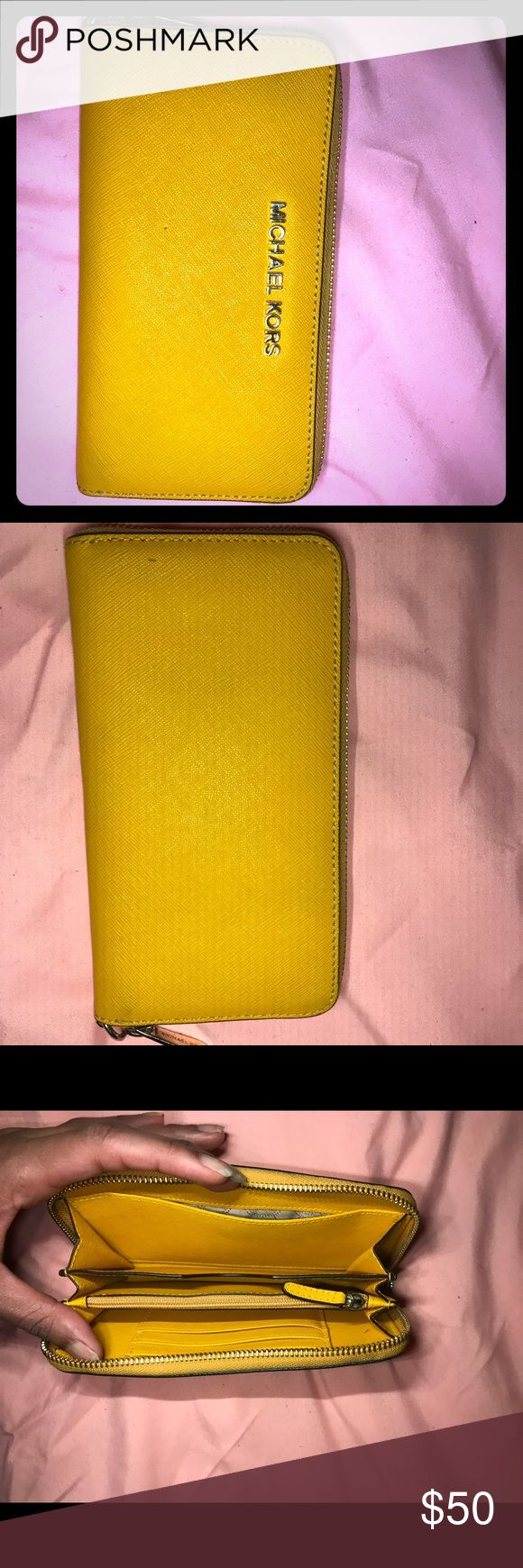 Michael Kors Wallet (with cell phone pocket) This wallet have been gently used. It has a pocket for cell phones, a cash flap, coin pocket and 3 slots for cards/ID. Bright yellow with gold accents. Michael Kors Bags Wallets