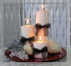 candle grouping , inagine black,silver and pink candles or white with the ribbons in your colors on the charger.