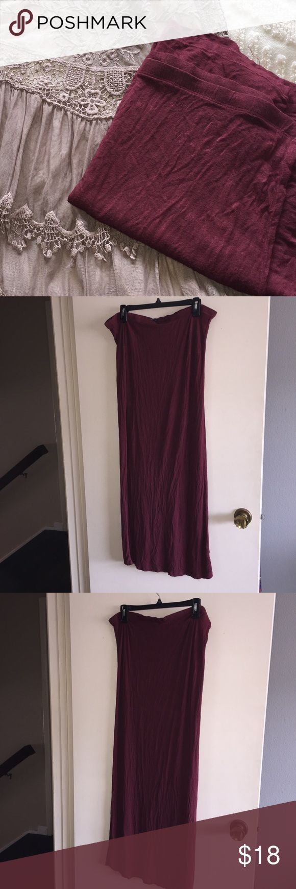 Brandy Melville Burgundy Maxi Skirt super soft and flowy lightweight burgundy maxi skirt from Brandy Melville, says one size fits all but the waist measures at 19 inches flat across so i'm listing it as a large! this skirt is sure to pair great with a pretty tank top or over a swimsuit!  ✨just trying to clean out my closet, make a reasonable offer!✨ Brandy Melville Skirts Maxi