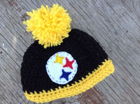 Custom made football team logo hats. Featured in the photos are two 6 month old size hats. One of these hats that will be the perfect accessory for your little one to cheer on the NFL!  The Steelers: A black hat with yellow trim and a yellow pompom. And the Steelers symbol on the front. The Bangels: And orange hat with black trim and a black pompom. And the bangels symbol on the front. **If you dont see your team or would like another option, please send me a message and I would be happy to…