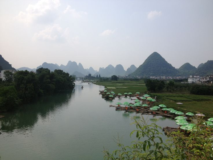This is the Li River.  It flows through Yangshuo and near Guilin. We took the bamboo rafts this time instead of the tourist boat...it was so peaceful just tooling along.