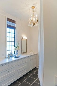 Pics On Divine French galley bathroom with white walls and crystal chandelier shining light upon gorgeous white bathroom vanity with inset cabinets and white marble