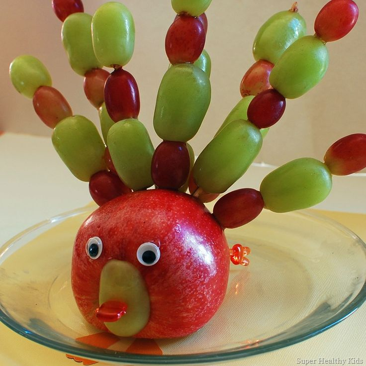 * An apple, turned on it's side, with the bottom sliced off to make it flat.      * Googly eyes, fixed on with peanut butter      * Half a grape for the beak (they were HUGE grapes)      * a bento toothpick with a flat thingy on the end of it.      * Skewers with grapes      * More toothpicks to prop him up in the back, because he became too back heavy.