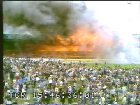 It's terrifying how quickly this goes from some smoke to a conflagration. Peace to the victims.  ▶ fire in soccer stadium - Great Britain. - YouTube